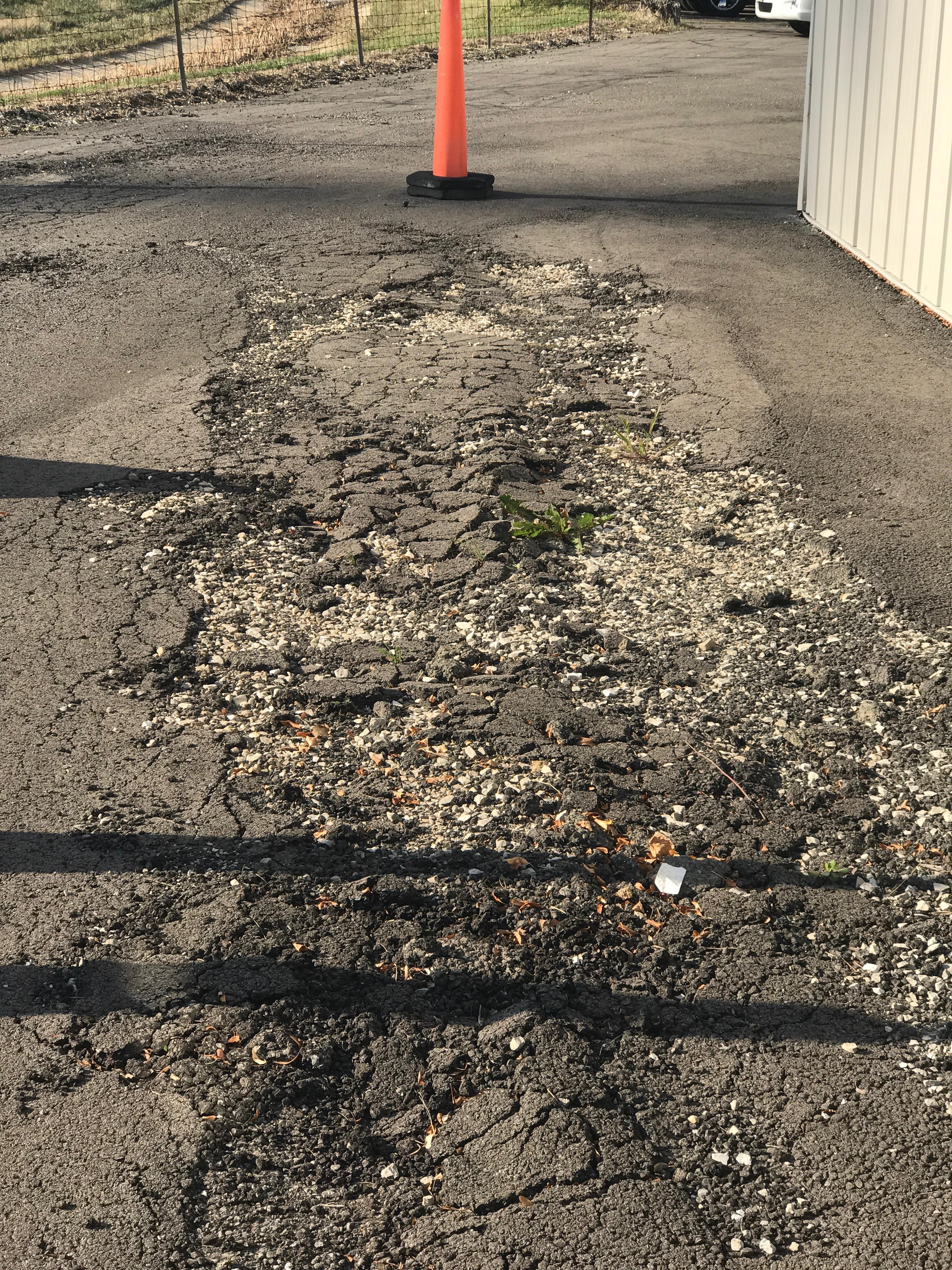 bad asphalt parking lot base