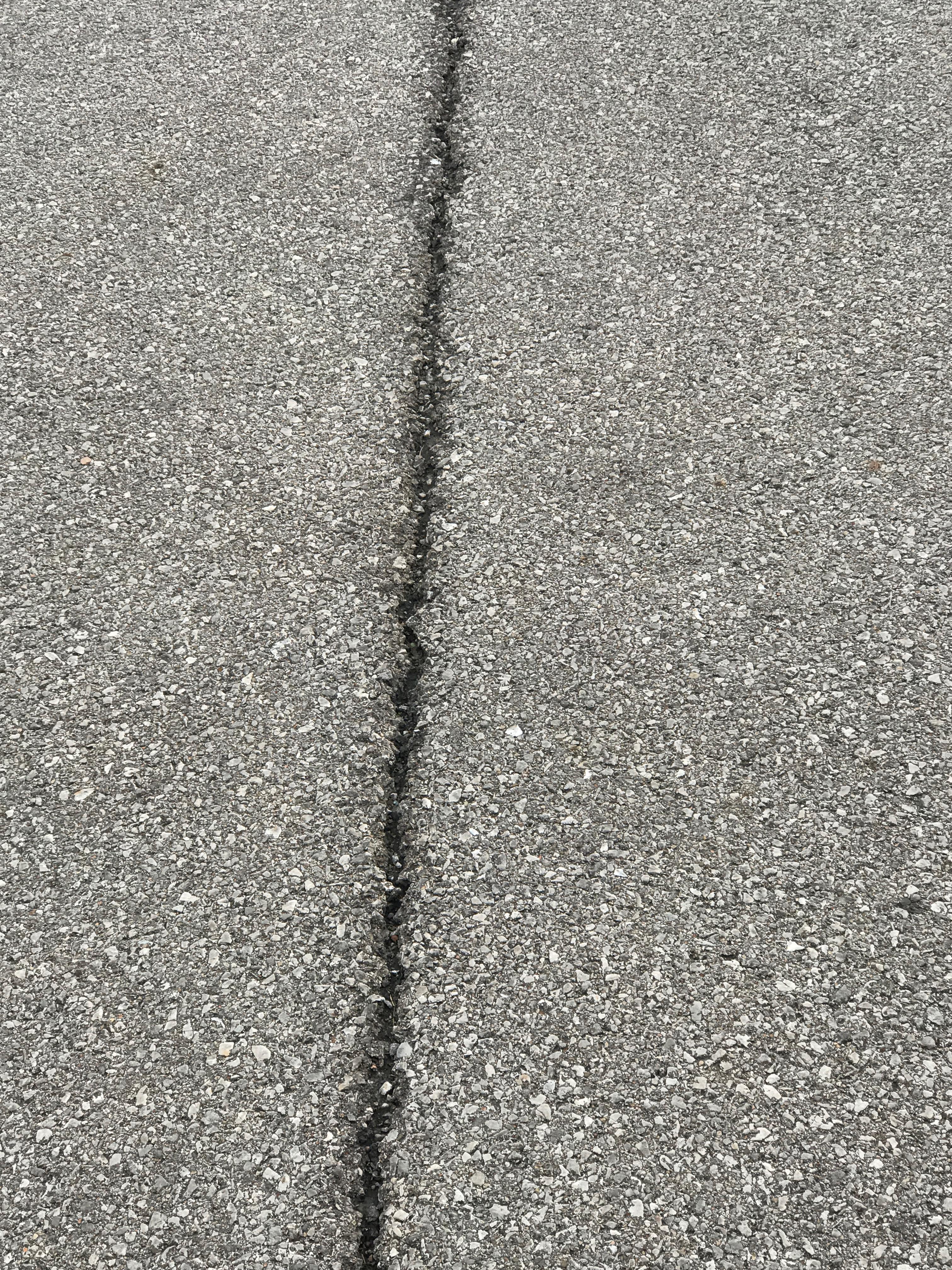asphalt parking lot crack